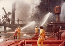 Fire teams in action on Al Ahood's main deck, following two Exocet hits on the tanker in May 1984.